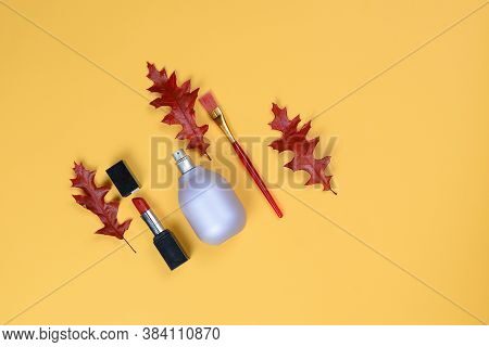 Perfume Bottle Lavender-colored,lipstick,bruch Lies Beautifully On A Yellow Background With Orange T