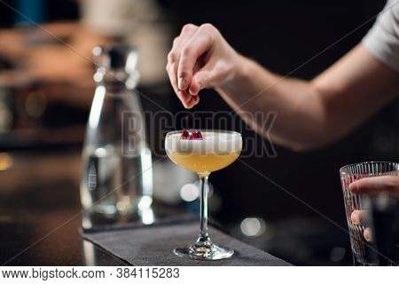 Close-up Of A Glass With A Beautiful Delicious Cocktail Standing On The Table In A Restaurant. The B