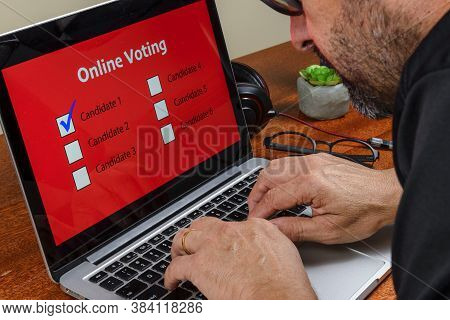 Person Voting On The Computer Over The Internet With The Text Online Voting