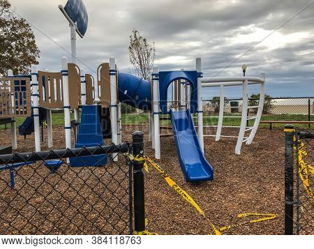 NORWALK,CT, USA-SEPTEMBER 3, 2020: Empty and closed  playground during COVID 19 on Calf Pasture Beach