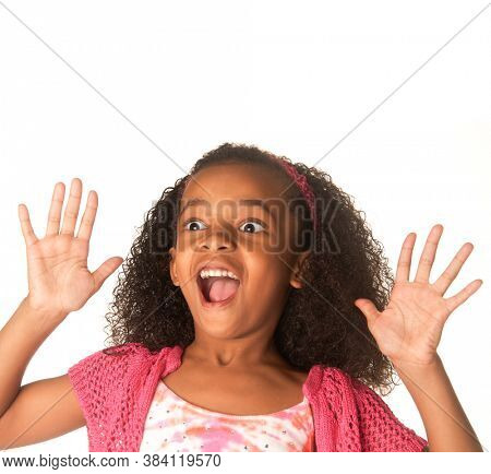 Cute child playfully acting surprised or scared.
