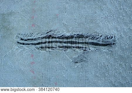 Gray Fabric Texture From A Piece Of Torn Matter On Clothes