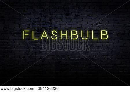 Neon Sign On Brick Wall At Night. Inscription Flashbulb