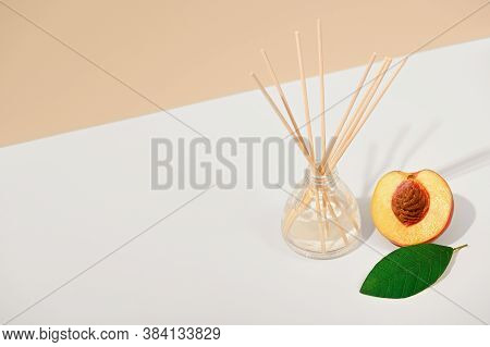 Air Fragrance With Reed Sticks On A White Beige Background. Natural Fruit Scent, Interior Scent. Lux