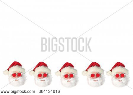 Santa Claus. Christmas Theme.  Santa Claus wears Red Sunglasses. Isolated on white.