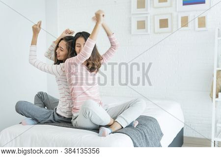 Two Pretty Best Friends Forever Girlfriend Talk, Hug And Laugh Together On Bed At Cozy Home Relation