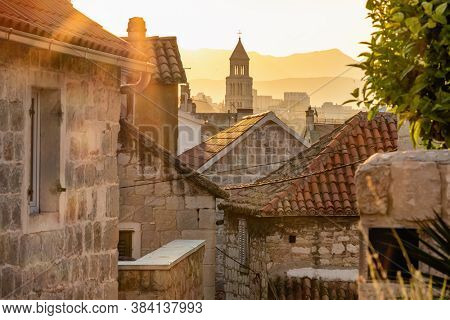 Sunrise over the Split old town. Narrow medieval paved street in old town of Split at sunrise, Croatia