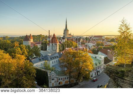 Top view of Tallinn old town at autumn, Estonia. Iconic view of the city. Tallinn city wall and St. Olaf's Church