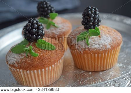 Muffins - Delicious Pastries. Delicious Dessert On The Table - Homemade Muffins. Portioned Cupcakes.