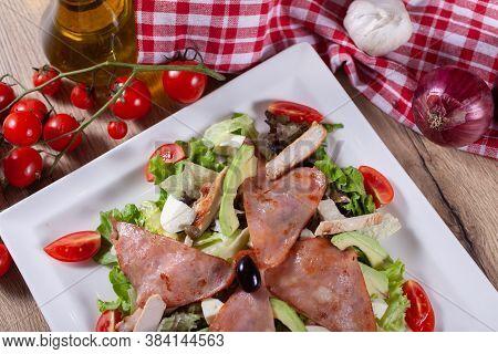 Green Salad With Avocado, Arugula, Capers, Cherry Tomatoes, Mozzarella And Baked Ham