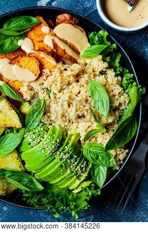 Vegan Lunch Plate. Quinoa Salad With Baked Zucchini, Sweet Potato, Avocado And Tahini Dressing In A