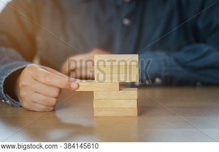Human Hand Choosing A Wooden Block In The Middle Represents A Different Idea. Business Leadership Fo