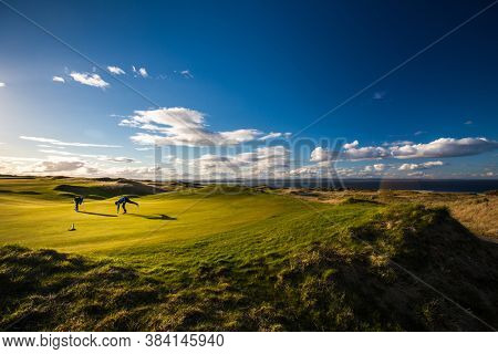 Golfers on a lovely golf course in St. Andrews, Scotland