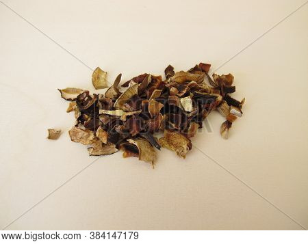 Dried Mushrooms, Bay Bolete And Porcino, On A Wooden Board