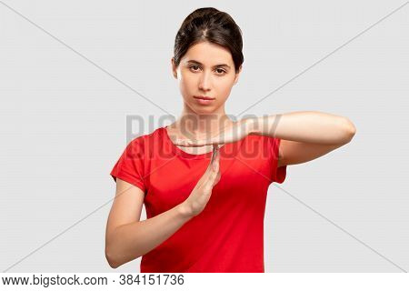 Time Out Gesture. Need Break. Tired Woman Showing Stop By Hands. Looking At Camera Isolated On Neutr