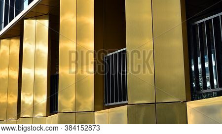 Combination Of Metal And Glass Wall Material. Steel Facade On Columns. Abstract Modern Architecture.