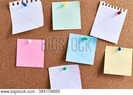 Sticky Notes Pinned On Cork Board. Planning And Brainstorming Concept