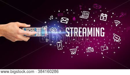 hand holding wireless peripheral with STREAMING inscription, social media concept