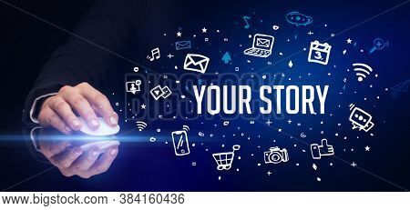 hand holding wireless peripheral with YOUR STORY inscription, social media concept