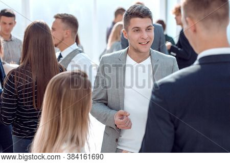 casual business man explaining something to his colleague