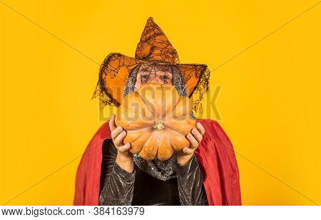 Witch Man In Hat And Cloak. Happy Halloween Yellow Background. Old Grandfather With Gray Beard. Devi