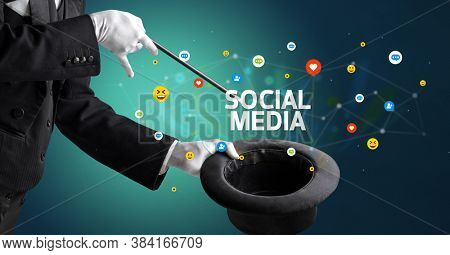 Magician is showing magic trick with SOCIAL MEDIA inscription, social media marketing concept
