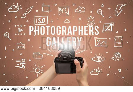 Hand taking picture with digital camera and PHOTOGRAPHERS GALLERY inscription, camera settings concept