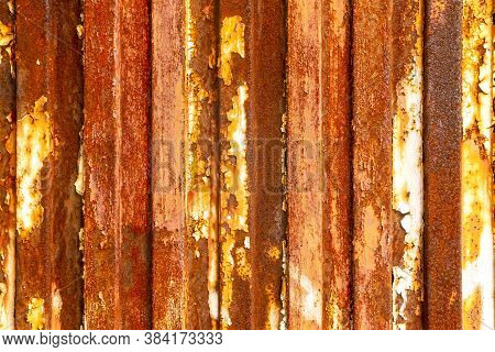 Old Rusty Fence Made Of Corroded Galvanized Material. Bright Abstract Texture