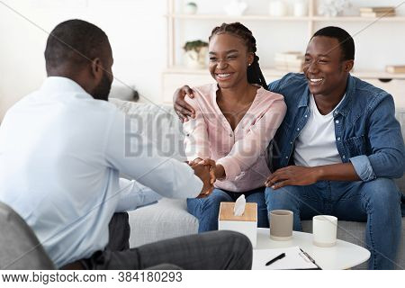 Marriage Reconciliation. Happy Black Couple Grateful To Family Counselor After Successful Therapy, S