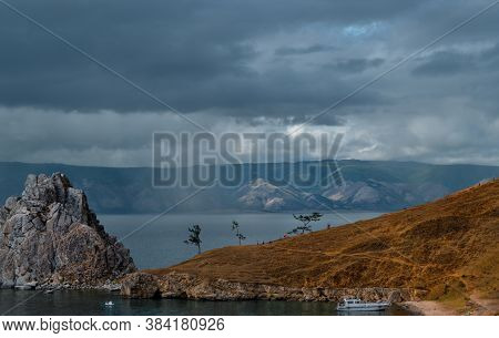 Cape Shamanka Rock In Lake Baikal Among The Mountains And Rain Clouds, Shower, Yacht, Ship