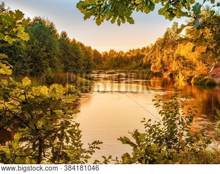 Small Forest River At Sunset In Autumn. Beautiful Landscape, Sunset On The River. Golden Sunset At T