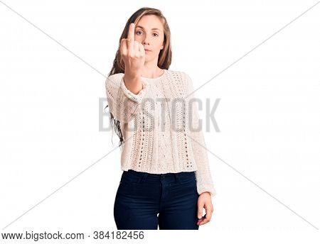 Young beautiful blonde woman wearing casual sweater showing middle finger, impolite and rude fuck off expression