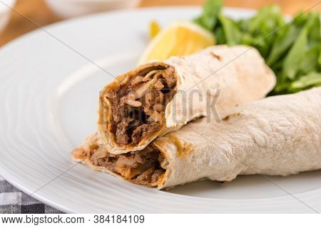 Turkish Shawarma Tantuni In Pita Bread On Wooden Table. Turkish Fast Food
