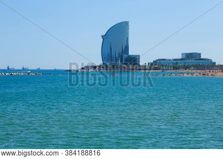 Barcelona, Spain - May 15, 2017: View To The Mediterranean Sea And Famous Modern W Barcelona Hotel,