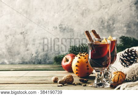 Mulled Wine With And Orange Slices On Wooden Table, Copy Space