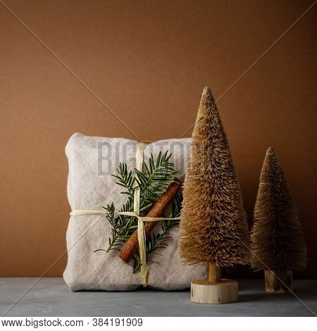 Fabric Wrapped Gifts, Zero Waste Beauty Body Care And House Cleaning Items And Wooden Christmas Deco
