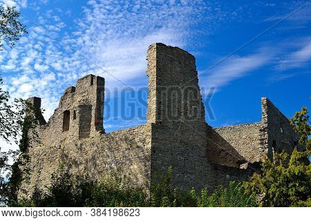 Picture Ruins Of A Medieval Castle With A Background Of Summer Sky With Fine Clouds, Hukvaldy, Czech