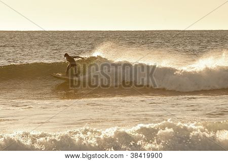 Surfer In Morning Light