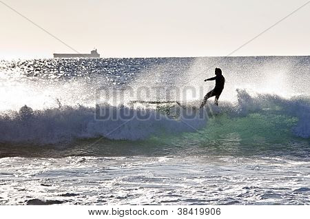 Surfer On A Wave With Boat