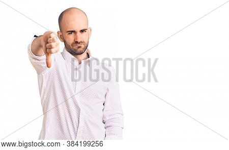 Young handsome man wearing elegant shirt looking unhappy and angry showing rejection and negative with thumbs down gesture. bad expression.