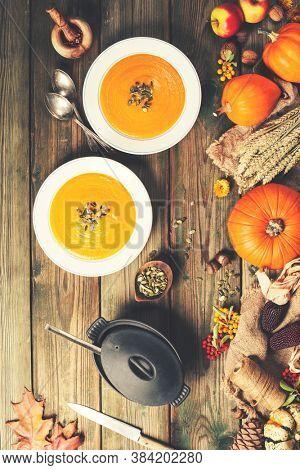 Vegetable or pumpkin soup and ingredients. Vegetable ingredients and homemade soup.