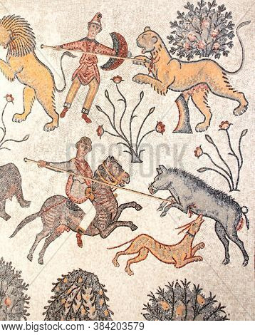 Ancient byzantine natural stone tile mosaics with a image of hunting on wild animals, Mount Nebo, Jordan, Middle East