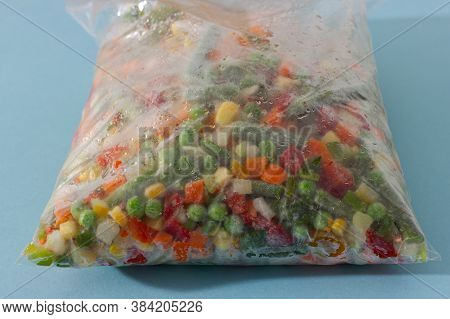 Mix Of Homemade Organic Frozen Vegetables In A Plastic Bag: Paprika, Carrot, Green Beans, Tomato And