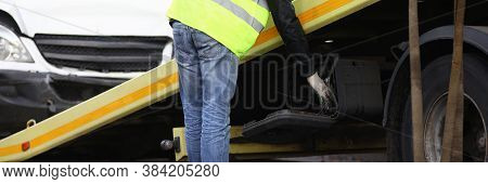 Crashed Car Loaded On Tow Truck Closeup. Traffic Failure Concept