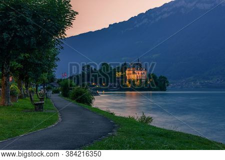Sunset At The Iseltwald Peninsula And Forme Castle In Switzerland, Now Rehabilitation Center Of Seeb