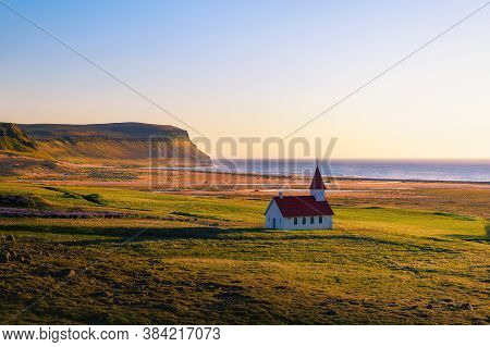 Sunset At The Breidavik Church Located At The Sand Beach In Westfjords, Iceland