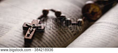 Christian Wooden Crucifix On Open Bible, Point Focus. Religious Concept Image