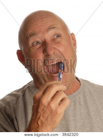 bald senior man brushing his teeth isolated on white background poster