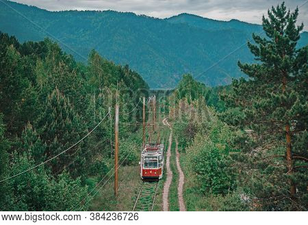 Streetcar Line Among Mountains And Forests. Republic Of Khakassia, Russia.
