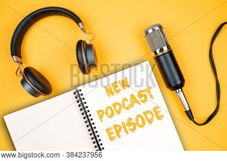 New Podcast Episode Text On Notepad Next To Headphones And Recording Microphone, Podcasting Concept